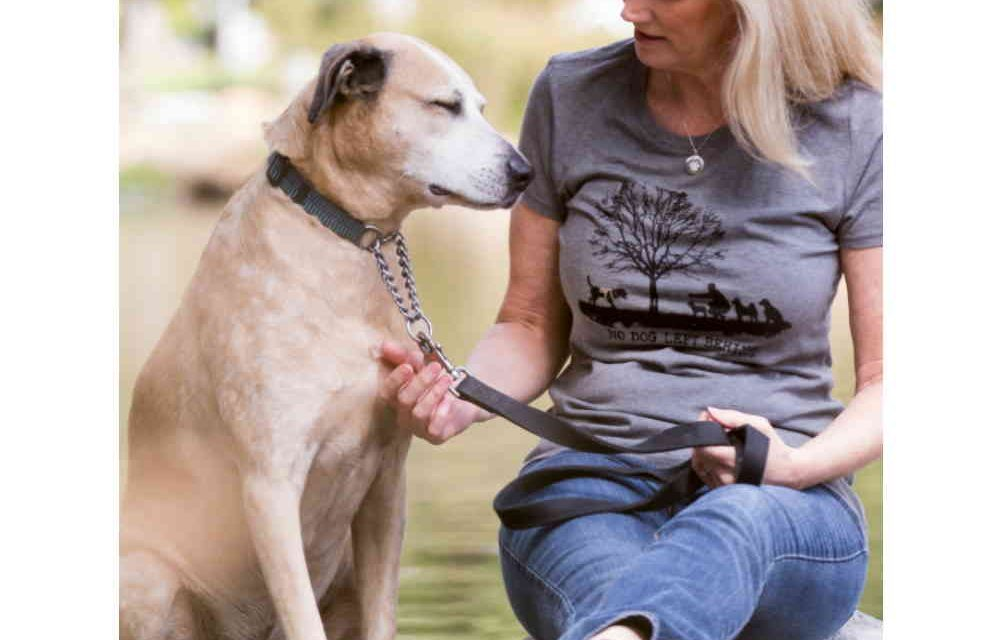 https://www.4pawzkw.com/wp-content/uploads/2021/03/t-shirt-woman-no-dog-left-behind3-1000x640.jpg